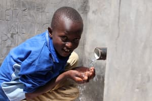 The Water Project: Elwichi Community, Mulunda Spring -  Victor Enjoying The Water