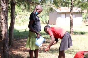The Water Project: Elwichi Community, Mulunda Spring -  Girls Demonstrate Handwashing