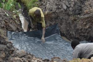 The Water Project: Isanjiro Community, Musambai Spring -  Foundation Setting