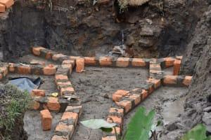 The Water Project: Isanjiro Community, Musambai Spring -  Brick Setting