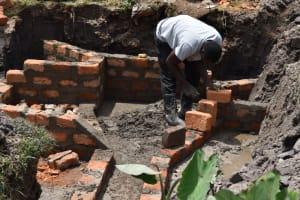 The Water Project: Isanjiro Community, Musambai Spring -  Wall Construction