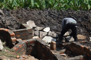 The Water Project: Isanjiro Community, Musambai Spring -  Stone Pitching