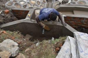 The Water Project: Isanjiro Community, Musambai Spring -  Plaster Works
