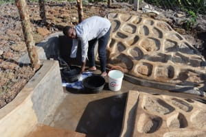 The Water Project: Isanjiro Community, Musambai Spring -  Collecting Water