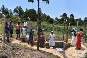 The Water Project: Isanjiro Community, Musambai Spring -  Community Members Celebrating At The Spring