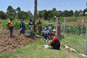 The Water Project: Isanjiro Community, Musambai Spring -  Improvising A Handwashing Leaky Tin