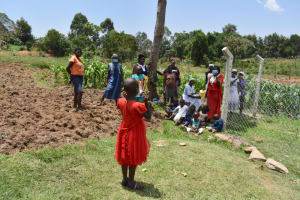 The Water Project: Isanjiro Community, Musambai Spring -  Mask Wearing Demonstration