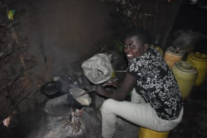 The Water Project: Bumira Community, Savai Spring -  Ashley Cooking Inside The Kitchen