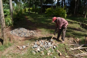 The Water Project: Bumira Community, Savai Spring -  Breaking Rocks Into Gravel