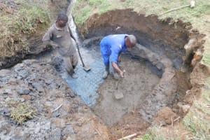 The Water Project: Mukoko Community, Zebedayo Mutsotsi Spring -  Laying The Foundation