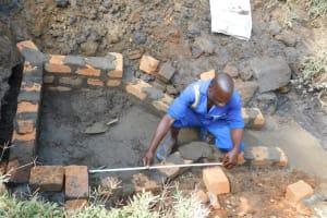 The Water Project: Mukoko Community, Zebedayo Mutsotsi Spring -  Wall Construction