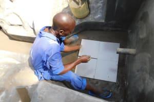 The Water Project: Mukoko Community, Zebedayo Mutsotsi Spring -  Setting The Tiles