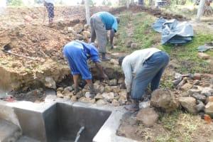 The Water Project: Mukoko Community, Zebedayo Mutsotsi Spring -  Stone Backfilling