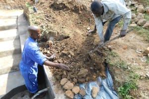 The Water Project: Mukoko Community, Zebedayo Mutsotsi Spring -  Backfilling With Soil