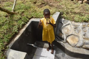 The Water Project: Mukoko Community, Zebedayo Mutsotsi Spring -  Nelly Drinking Clean Water From The Spring