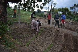 The Water Project: Mukhuyu Community, Gideon Kakai Chelagat Spring -  Grass Planting