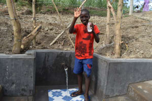 The Water Project: Mukhuyu Community, Gideon Kakai Chelagat Spring -  Enoc Sharing Thanks For Clean Water