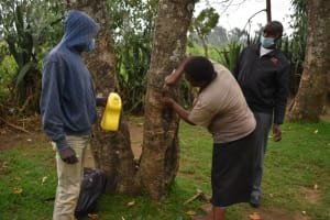 The Water Project: Mukhuyu Community, Gideon Kakai Chelagat Spring -  Installing A Leaky Tin For Handwashing
