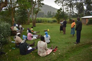The Water Project: Mukhuyu Community, Gideon Kakai Chelagat Spring -  Elected Water User Committee Leaders Address Participants