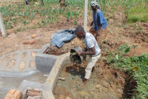 The Water Project: Shihome Community, Oloo Njinuli Spring -  Backfilling With Clay