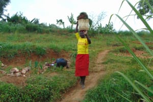 The Water Project: Shihome Community, Oloo Njinuli Spring -  Transporting Grass For Planting At The Spring