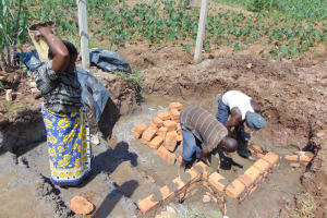 The Water Project: Shihome Community, Oloo Njinuli Spring -  Brick Setting