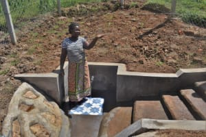 The Water Project: Shihome Community, Oloo Njinuli Spring -  Holding Up A Glass Of Clean Water