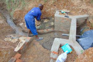 The Water Project: Shianda Commnity, Mukeya Spring -  Stone Pitching