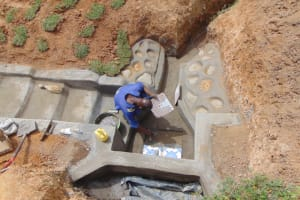 The Water Project: Shianda Commnity, Mukeya Spring -  Setting The Tiles