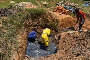 The Water Project: Shianda Commnity, Mukeya Spring -  Laying The Foundation