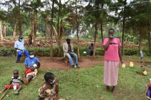 The Water Project: Shianda Commnity, Mukeya Spring -  Elizabeth Demonstrates Toothbrushing