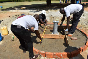The Water Project: Ibokolo Primary School -  Constructing Permanent Well Pad