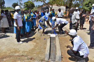 The Water Project: Ibokolo Primary School -  Enjoying The Official First Drops Of Water