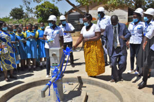 The Water Project: Ibokolo Primary School -  Madam Chief Cutting The Ribbon To Officially Launch Ibokolo Primary Well
