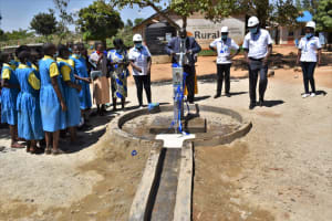 The Water Project: Ibokolo Primary School -  School Headteacher Tries Out The Pump