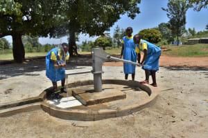 The Water Project: Ibokolo Primary School -  Splashing Water