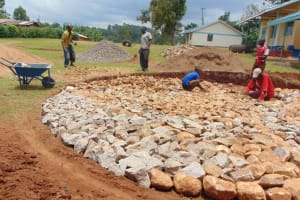 The Water Project: Gidimo Primary School -  Laying Rock Foundation