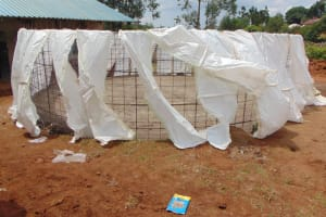 The Water Project: Gidimo Primary School -  Tying Sacks To Wire