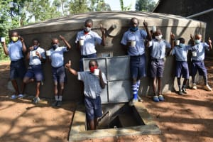 The Water Project: St. Martin's Primary School -  Boys Give Thumbs Up At The Rain Tank