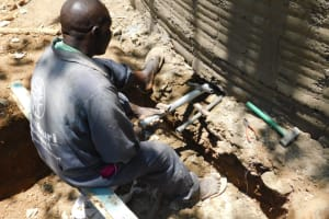The Water Project: St. Martin's Primary School -  Setting Tap And Drainage Pipes