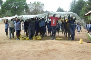 The Water Project: St. Martin's Primary School -  Students Help In Dome Installation