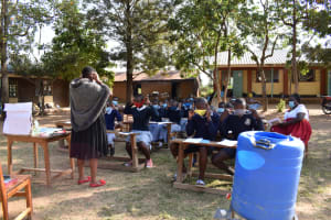 The Water Project: St. Martin's Primary School -  Demonstration On How To Wear Masks Well