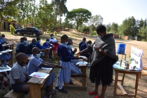 The Water Project: St. Martin's Primary School -  Explanation And Demonstration On How To Use Hand Sanitizer