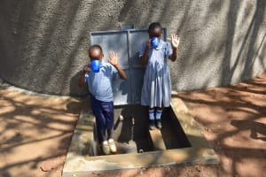 The Water Project: St. Martin's Primary School -  Pupils Drinking Clean Water