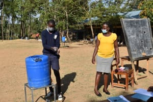 The Water Project: St. Martin's Primary School -  Student Clinton Shows Handwashing Steps