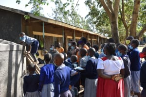 The Water Project: St. Martin's Primary School -  Students Look Inside Rain Tank