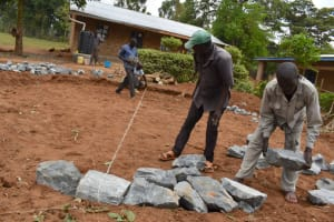The Water Project: Jimarani Primary School -  Measurement And Setting Of The Stones