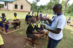 The Water Project: Jimarani Primary School -  Distributing Writing Materials