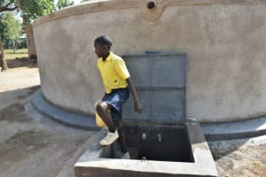 The Water Project: Jimarani Primary School -  Leaving The Rain Tank With Water