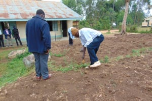 The Water Project: Kitambazi Primary School -  Measuring The Site